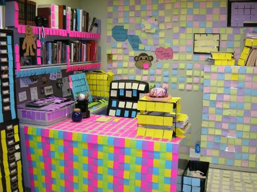 Desk Covered with Postit Notes